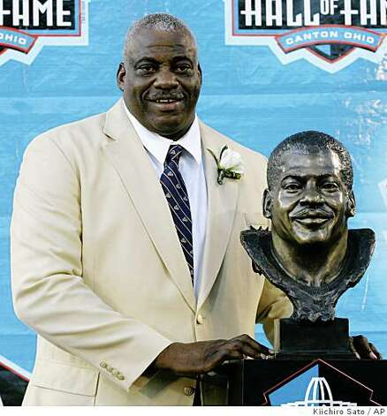 Former 49ers defensive end Fred Dean stands next to his bronze bust at the Pro Football Hall of Fame Saturday, Aug. 2, 2008, in Canton, Ohio. Photo: Kiichiro Sato, AP