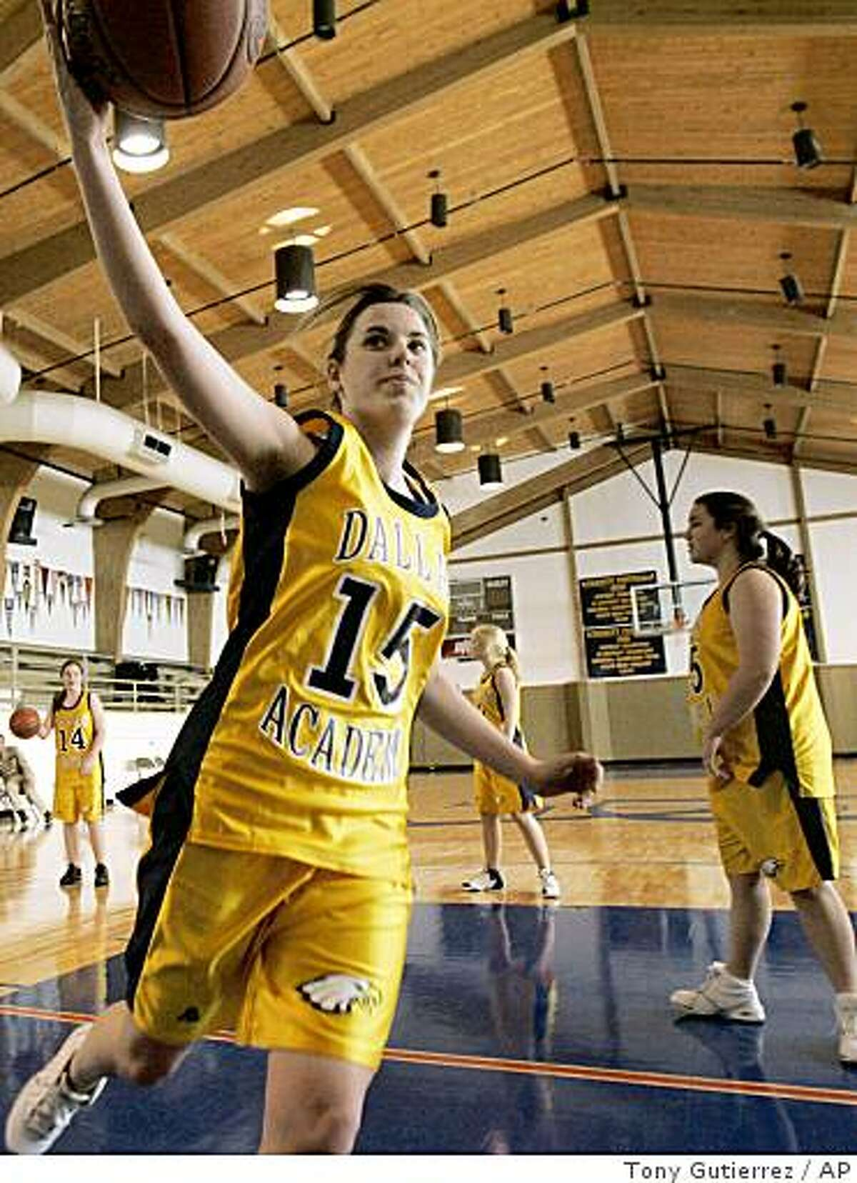 Dallas Academy's Samantha Peloza (15) grabs a rebound during a shoot-around with teammates in the schools gymnasium in Dallas, Thursday, Jan. 22, 2009. Covenant, a private Christian school in Dallas, defeated Dallas Academy 100-0 last week. The winning school now says it wants to do the right thing by seeking a forfeit and apologizing for the margin of victory. (AP Photo/Tony Gutierrez)