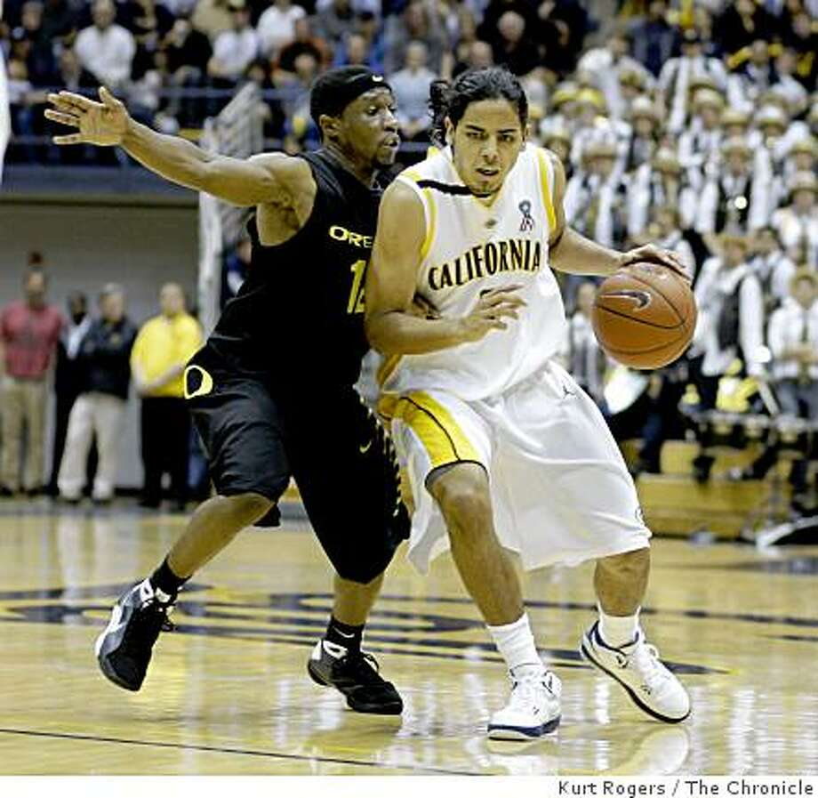 Cal's Jorge Gutierrez is guarded by Oregon's Tajuan Porter in the second period .. on Saturday Jan 24,  2009 in Berkeley , Calif Photo: Kurt Rogers, The Chronicle