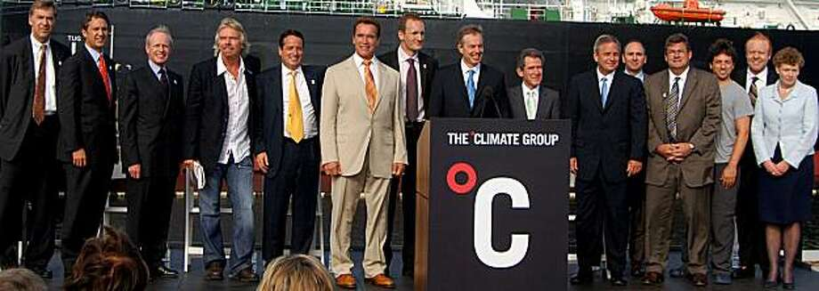 (At Long Beach): Richard Branson (fourth from left), Governor Schwarzenegger, and Tony Blair join business leaders at a climate and energy meeting hosted by The Climate Group in Long Beach, California in 2006. (Additional information:  The people in thisphoto, listed from left to right are: Tracy Wolstencroft, Managing Director of Goldman Sachs; Rick Lazio, Executive VP and Head of Government Affairs and Public Policy, JPMorgan Chase; John Bryson, CEO of Edison International; Richard Branson, Founder ofVirgin Group; Kevin Davis, CEO of MAN Financial; Governor Arnold Schwarzenegger; Steve Howard, CEO of The Climate Group; UK Prime Minister Tony Blair; Lord John Browne of Madingley, CEO of BP; Chad Holliday Jr., CEO of Dupont; Tom King, President and C Photo: The Climate Group