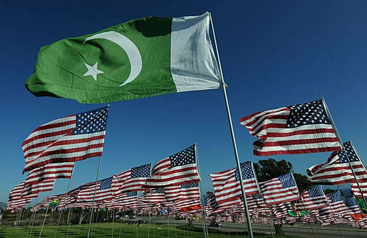 The flag of Pakistan representing a 9/11 victim from that country, flies amongst American flags erected by students and staff from Pepperdine University in Malibu, who placed nearly 3000 flags in the ground to honor the victims of the September 11, 2001 terrorist attacks in New York, on September 10, 2010. An impassioned President Barack Obama warned Americans must not turn on one another over religion, after rows over Islam sparked global fury, nine years after the September 11 attacks. Obama also mounted a strident defense of American Muslims, paid tribute to believers fighting in the US armed forces, and said US citizens must remember who their true enemies were -- naming Al-Qaeda and