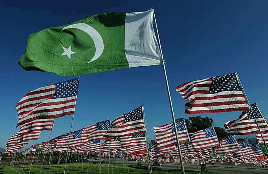 "The flag of Pakistan representing a 9/11 victim from that country, flies amongst American flags erected by students and staff from Pepperdine University in Malibu, who placed nearly 3000 flags in the ground to honor the victims of the September 11, 2001 terrorist attacks in New York, on September 10, 2010.   An impassioned President Barack Obama warned Americans must not turn on one another over religion, after rows over Islam sparked global fury, nine years after the September 11 attacks. Obama also mounted a strident defense of American Muslims, paid tribute to believers fighting in the US armed forces, and said US citizens must remember who their true enemies were -- naming Al-Qaeda and ""terrorists."" The President has vowed a ""new beginning"" with Isl Photo: Mark Ralston, AFP/Getty Images"