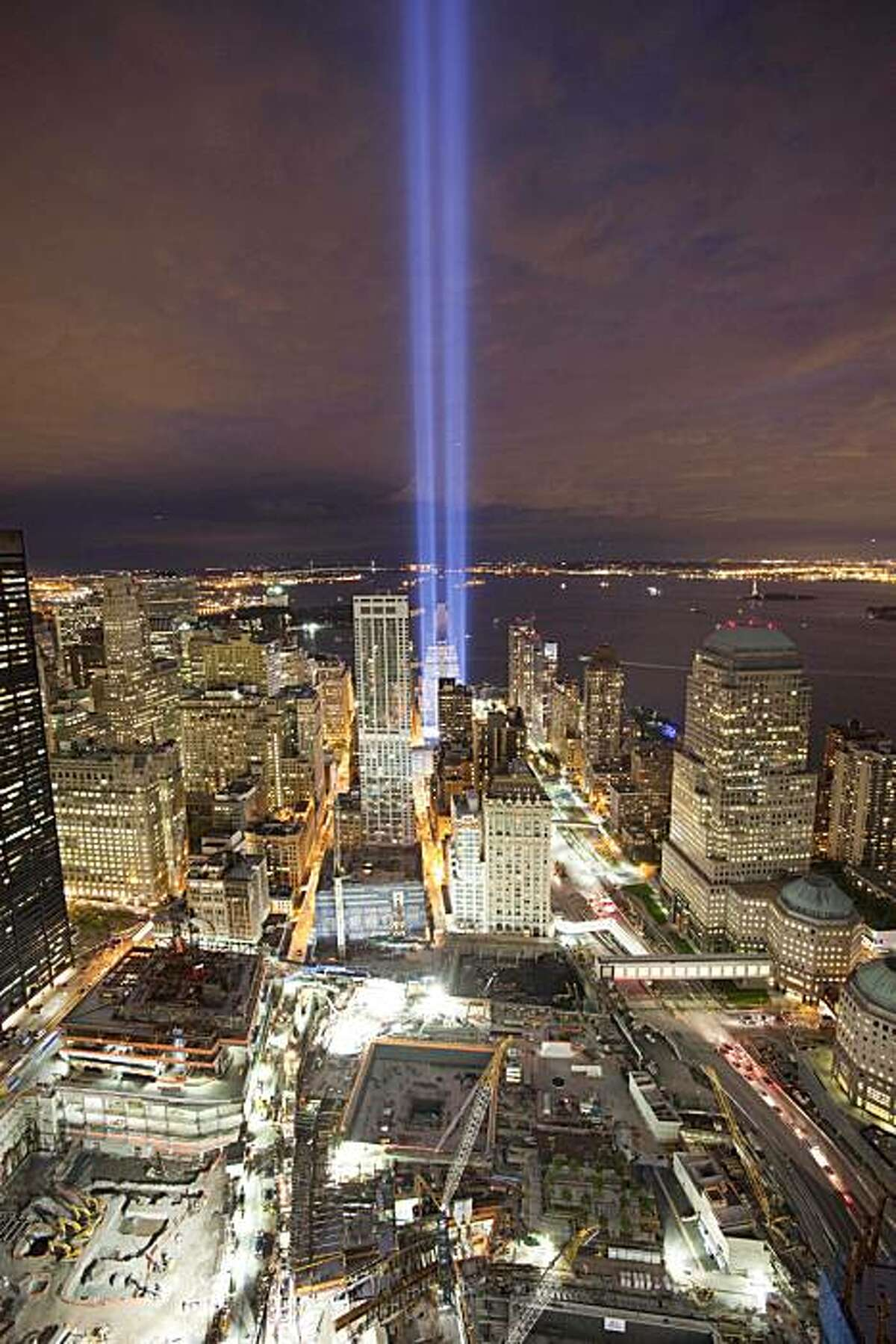 The Tribute in Light shines above the World Trade Center site, bottom, and the lower Manhattan skyline, Friday, Sept. 10, 2010 in New York. Saturday will be the ninth anniversary of the attacks on the World Trade Center.