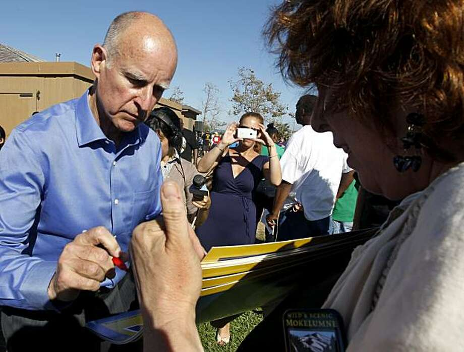 Democratic candidate for governor Jerry Brown signs an autograph for a supporter after speaking to union members at the annual Alameda Labor Council picnic at Shoreline Park in Oakland, Calif. on Monday, Sept. 6, 2010. Photo: Paul Chinn, The Chronicle
