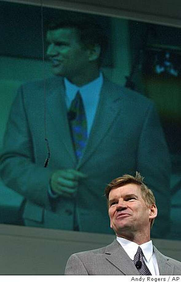 Below a live video feed of himself, the Rev. Ted Haggard delivers a sermon to those gathered at the New Life Church in Colorado Springs, Colo., in 2002. Photo: Andy Rogers, AP