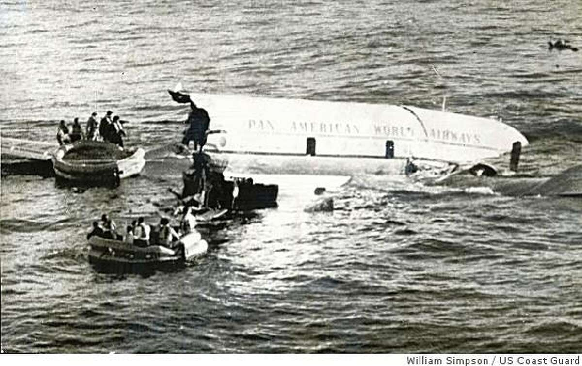 """Life rafts pull away from the """"Sovereign of the Skies"""" just before the broken craft settles to her grave in the Pacific Ocean on Oct. 16, 1956."""