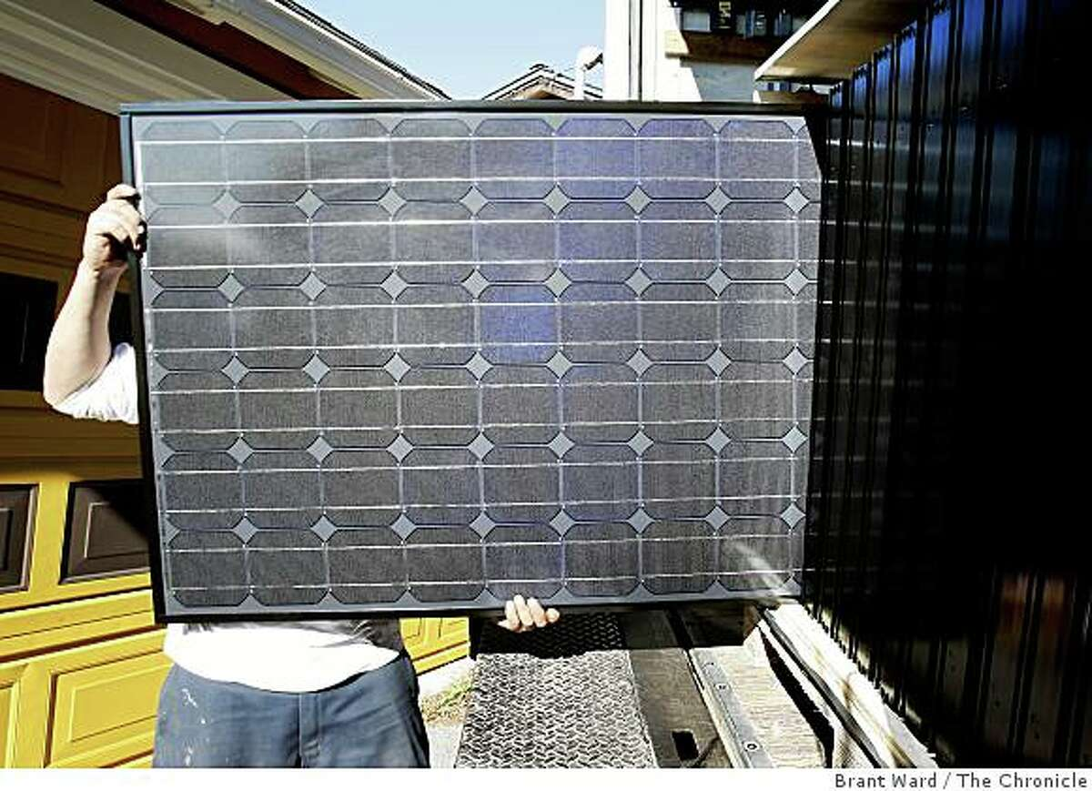 A solar panel is unloaded from a truck at the Oakland home. The solar industry has been a bright spot in a down economy. The Los Gatos based company Akeena Solar is installing 44 solar panels on a home in the Oakland hills Thursday January 15, 2008.