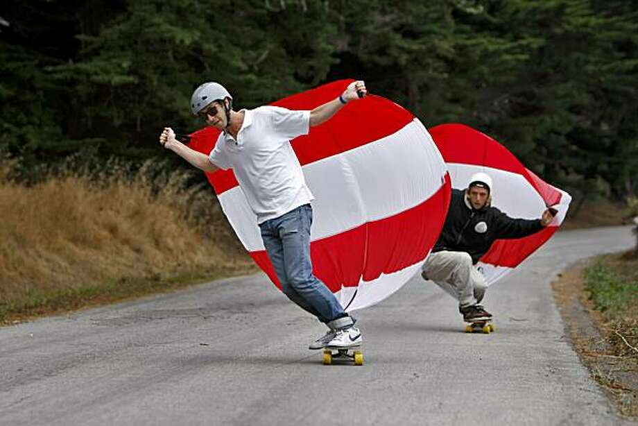 NIck Smith, inventor of Sporting-Sail rides his skateboard with his device, with his friend Jack Duysen, Thursday August 19, 2010, in Sausalito, Calif. Photo: Lacy Atkins, The Chronicle