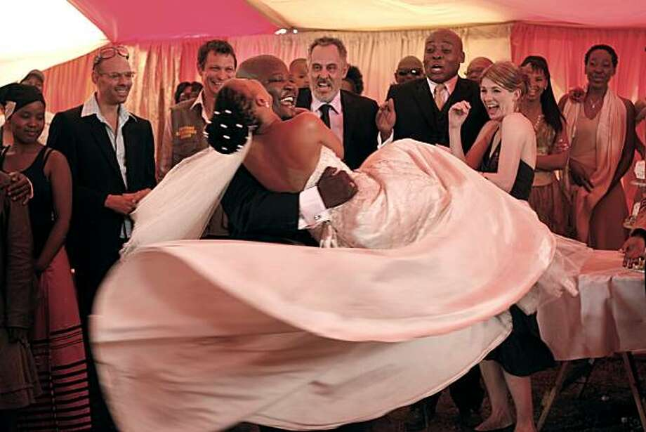 Kenneth Nkosi, holding Zandie Msutwana, Rapulana Seiphemo, and Jodie Whittaker appear in White Wedding. Photo: Courtesy Of Little Film Company