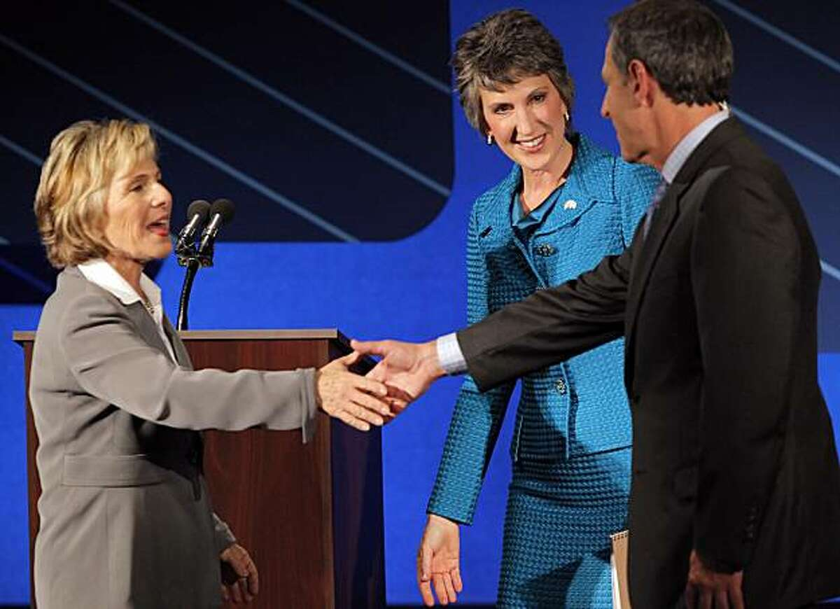 U.S. Sen. Barbara Boxer, left, shakes hands with debate moderator, Randy Shandobil, right, as republican candidate for U.S. Senate Carly Fiorina looks on following a debate on the Saint Mary's College campus in Moraga, Calif,. on Wednesday, September 1, 2010.