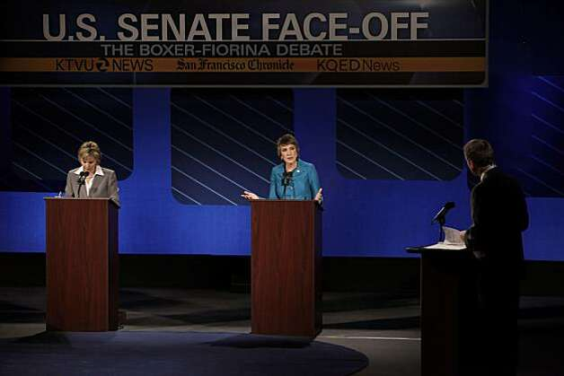 Republican candidate for U.S. Senate Carly Fiorina, center, answers a question by debate moderator, Randy Shandobil, right, as she and  U.S. Sen. Barbara Boxer participate in a debate on the Saint Mary's College campus in Moraga, Calif,. on Wednesday, September 1, 2010. Photo: Carlos Avila Gonzalez, The Chronicle