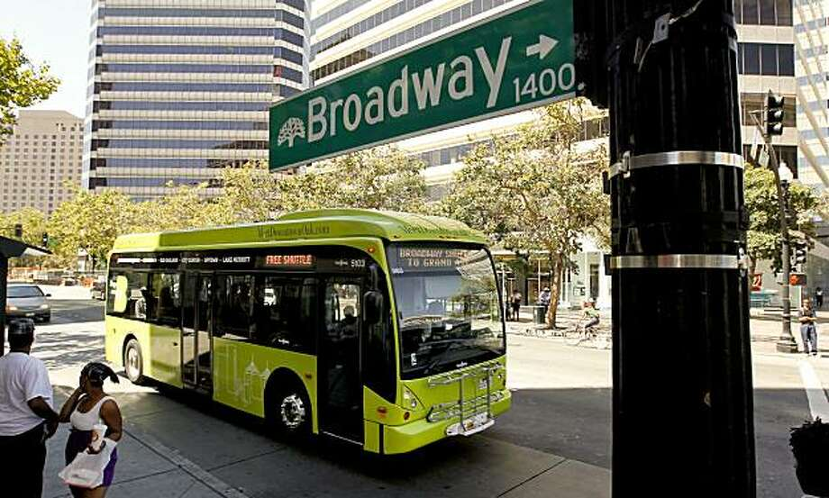 Oakland officials have started a free bus service that they say they hope will unify its sprawling downtown. The Broadway shuttle goes from Lake Merritt, through Uptown, Chinatown and down to Jack London Square. Photo: Michael Macor, The Chronicle