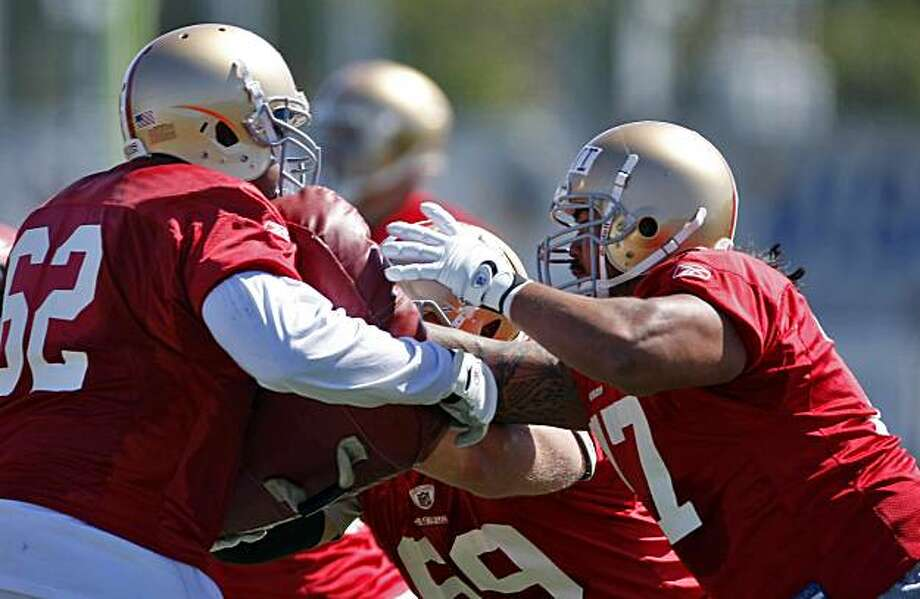 San Francisco 49ers  offensive line rookie Mike Iupati, right,  works on drills at practice, Sunday Aug. 1, 2010, in Santa Clara, Calif. Photo: Lacy Atkins, The Chronicle