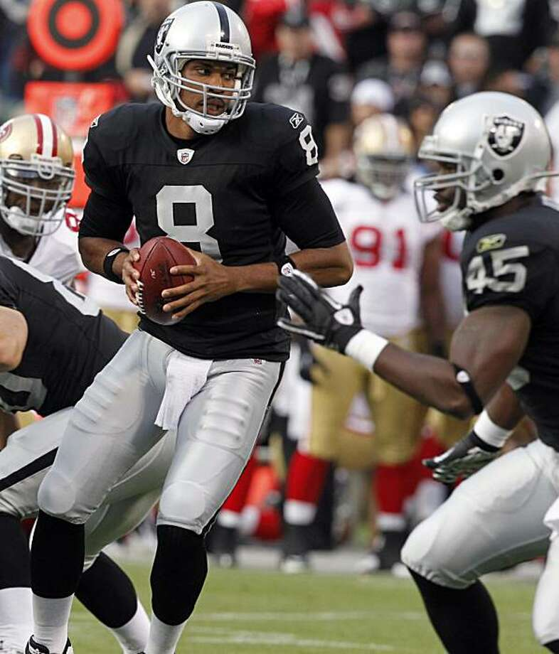 Raiders quarterback Jason Campbell goes back to pass in the second quarter of the Oakland Raiders vs. San Francisco 49ers pre-season football game at the Coliseum in Oakland, Calif. on Saturday, Aug. 28, 2010. Photo: Paul Chinn, The Chronicle