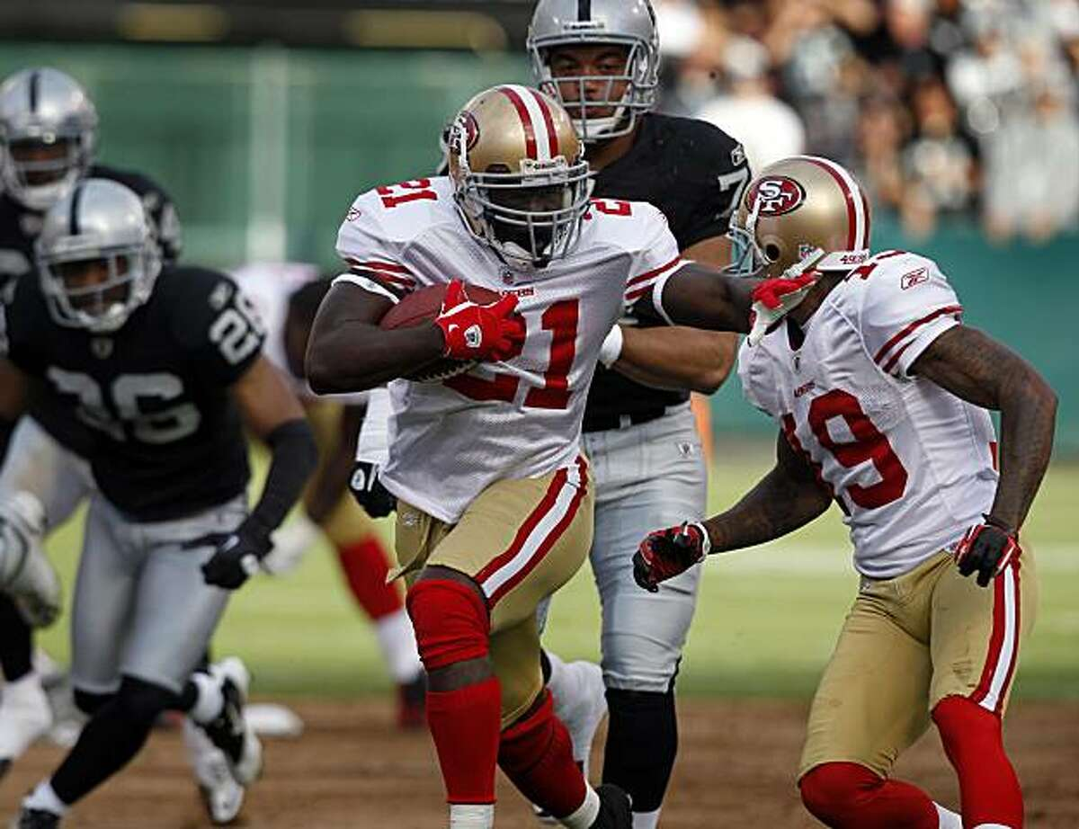 Running back Frank Gore busts through for a 49-yard gain in the first quarter of the Oakland Raiders vs. San Francisco 49ers pre-season football game at the Coliseum in Oakland, Calif. on Saturday, Aug. 28, 2010.