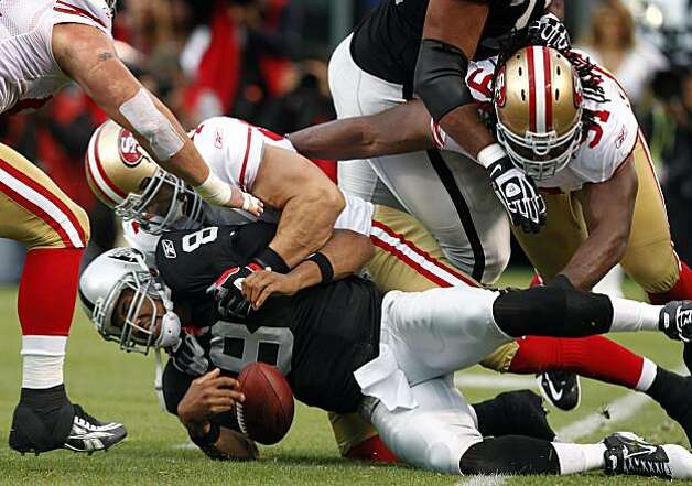 Raiders quarterback Jason Campbell left the game after a hard-hitting sack from the 49ers' Travis LaBoy in the second quarter in Oakland on Saturday. Photo: Paul Chinn, The Chronicle