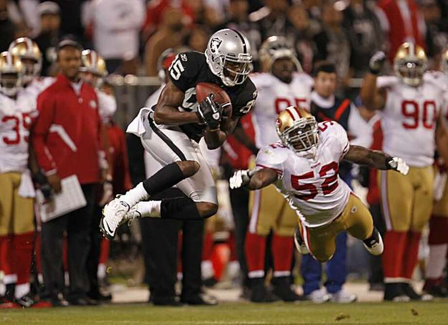 Oakland's Darrius Heyward-Bey with a 17 yards pass completion in the third quarter, covered by 49ers 52-Patrick Willis, as the Oakland Raiders take on the San Francisco 49ers in NFL pre-season action on Saturday August 28, 2010 in Oakland, Calif. Photo: Michael Macor, The Chronicle