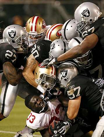San Francisco running back Anthony Dixon is separated from his helmet in the fourth quarter against the Raiders in Oakland on Saturday. Photo: Paul Chinn, The Chronicle