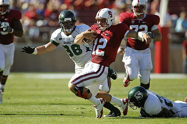 Stanford quarterback Andrew Luck scrambles for a first down in the first quarter against Sacramento State in Palo Alto on Saturday. Photo: Michael Macor, The Chronicle