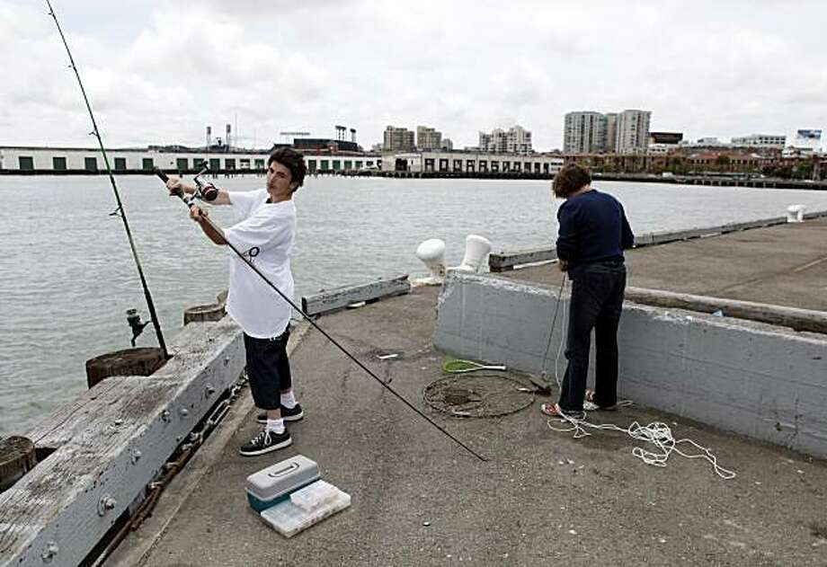 Bobby Jones, 15, of San Francisco, fishes with his aunt, Cora Smith, on Pier 30 in San Francisco, Calif., on Tuesday, June 9, 2009.The S.F. Port Commission is scheduled to approve a contract with DPW today for design and construction of a proposed cruise terminal that has been a hotbutton issue in SF stretching back through Brown's administration. It is a big step forward for the project, as it indicates that it truly might become a reality. Photo: Carlos Avila Gonzalez, The Chronicle