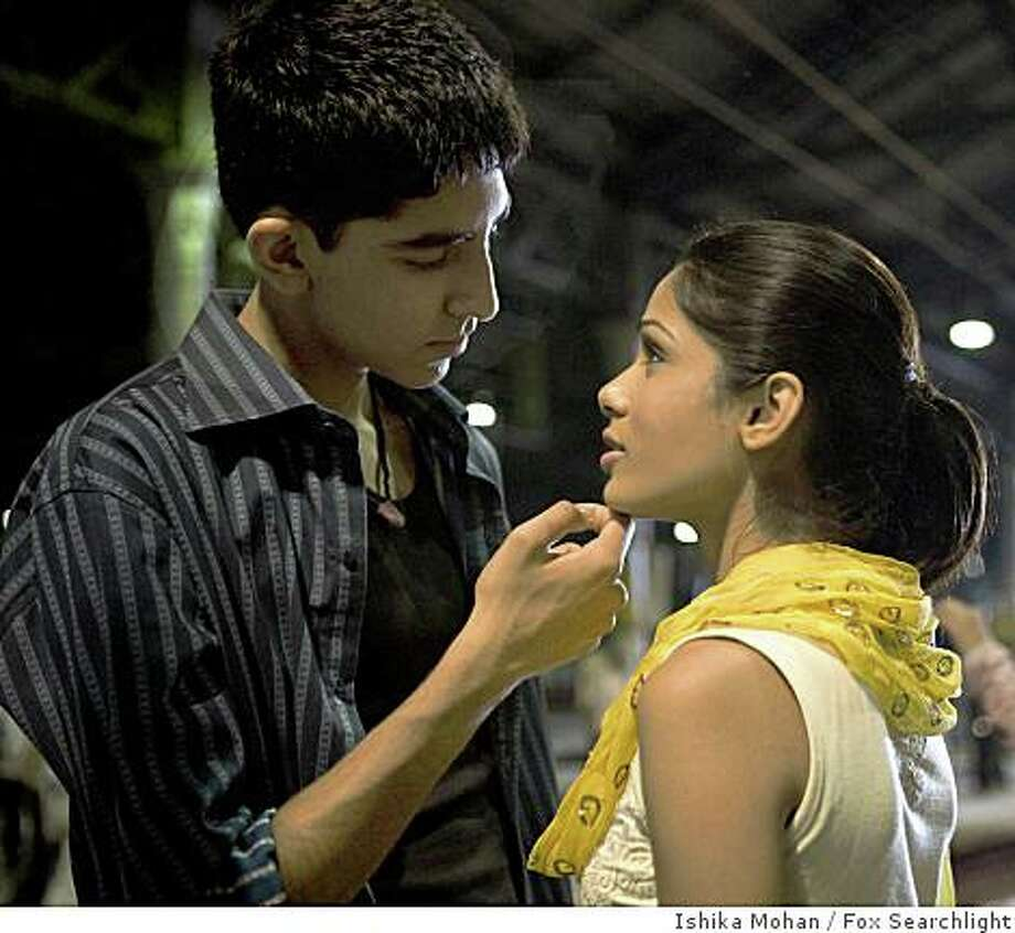 "In this image released by Fox Searchlight pictures, Dev Patel, left, and Freida Pinto are shown in a scene from ""Slumdog Millionaire."" Photo: Ishika Mohan, Fox Searchlight"
