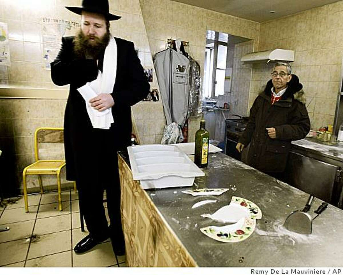 Rabbi Israel Belimow, left, stands in the pizzeria of Ohr Menahem Community Center in St. Denis, outside Paris, Monday Jan. 12, 2009. The center, which houses a day care center for autistic children, a restaurant, and a synagogue was attacked with several Molotov cocktails Sunday evening. It was the latest in a series of anti-Semitic incidents in France since Israel began its offensive in Gaza against Hamas militants Dec. 27. France has Western Europe's largest Jewish and Muslim populations, and Mideast tensions have spilled over into incidents in France in the past. (AP Photo/Remy de la Mauviniere)