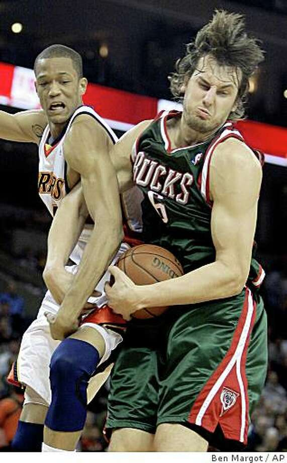 Milwaukee Bucks' Andrew Bogut, right, brings down a rebound against  Golden State Warriors' Anthony Randolph during the first half of an NBA basketball game Wednesday, Dec. 10, 2008, in Oakland, Calif. (AP Photo/Ben Margot) Photo: Ben Margot, AP