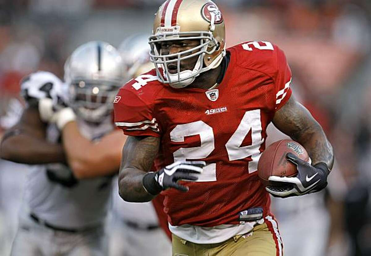 San Francisco 49er Michael Robinson (24) off and running in the first half as the San Francisco 49ers take on the Oakland Raiders at Candlestick Park in San Francisco, Calif., on Saturday August 22, 2009, in a pre-season game.