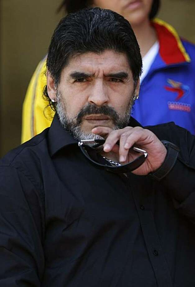 This July 22, 2010 file photo shows Argentina's national soccer team coach Diego Armando Maradona listening to a question from the press prior to his meeting with Venezuela's President Hugo Chavez, unseen, at Miraflores presidential palace in Caracas, Venezuela. Argentina's soccer federation has asked Maradona to replace most of his staff, jeopardizing his future as coach of the national team, members of the federation's executive committee said Tuesday July 27, 2010. Photo: Fernando Llano, AP