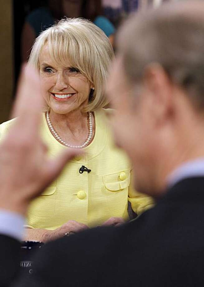 Arizona Gov. Jan Brewer, Republican, looks away as democratic gubernatorial candidate Terry Goddard gestures prior to a televised Arizona gubernatorial debate Wednesday, Sept. 1, 2010 in Phoenix. Photo: Matt York, AP