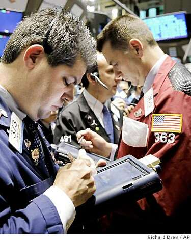 Traders work on the floor of the New York Stock Exchange Tuesday, Jan. 20, 2009.(AP Photo/Richard Drew) Photo: Richard Drew, AP