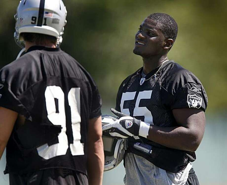 Rookie linebacker Rolando McClain (55), the Oakland Raiders' first-round draft pick from Alabama, pratices with teammate Trevor Scott (91) at the team's minicamp in Alameda, Calif., on Friday, April 30, 2010. Photo: Paul Chinn, The Chronicle