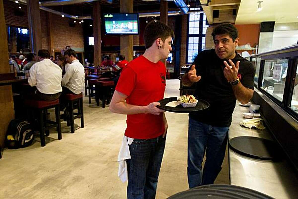 From left, Ryan Sprinkle and Jorge Sanchez discuss serving instructions at the newly-opened Pedro's Cantina in San Francisco, Calif. on Thursday, Sept. 2, 2010.
