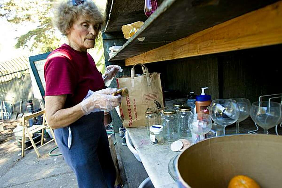 Helen, last name withheld, a volunteer and 20-year patron, organizes the a shelves of various free items at the Haight-Ashbury Neighborhood Council Recycling Center in San Francisco, Calif. on Wednesday, Sept. 1, 2010.