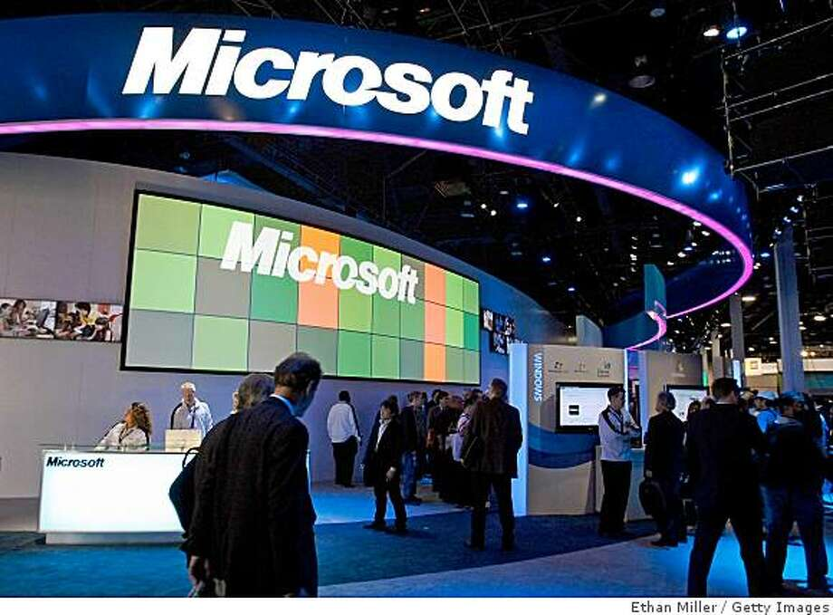 LAS VEGAS - JANUARY 08:  (FILE PHOTO) Visitors walk pass the Microsoft Corp. booth at the 2009 International Consumer Electronics Show at the Las Vegas Convention Center January 8, 2009 in Las Vegas, Nevada. Microsoft announced an 11 percent drop in second quarter profits and will cut 5,000 jobs over the following 18 months on January 22, 2009 in Redmond, Washington.  (Photo by Ethan Miller/Getty Images) Photo: Ethan Miller, Getty Images