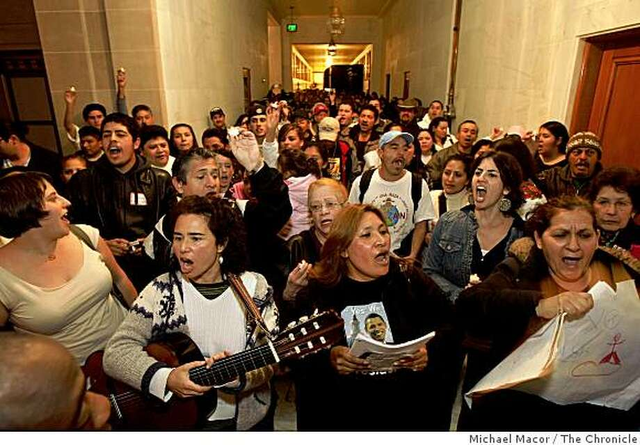 Moving through the hallways of the Supervisors offices, a large group of  immigrant rights activists stop in front of the Mayor's office, taking their protest to San Francisco City Hall on Wednesday Jan. 21, 2009, calling for legalization for undocumented workers and a moratorium on immigration raids. Photo: Michael Macor, The Chronicle