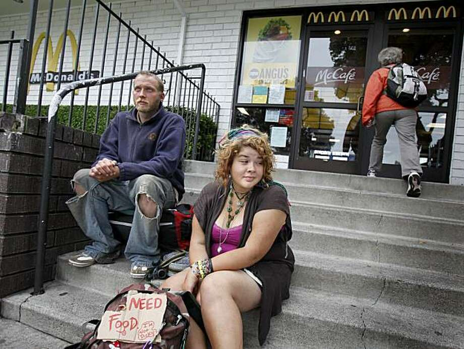 "Marissa Frazier (right) from Sacramento and Noah Leiser sat on the steps of the McDonalds Thursday August 26, 2010.  Both believe the ""dollar"" menu vanished because of them and think it is unfair.  Many of the young travelers who hang out near the end of Haight Street in San Francisco, Calif. believe the McDonalds there has removed the ""dollar"" menu in order to reduce the numbers of poor and homeless people visiting the fast food chain restaurant. Photo: Brant Ward, The Chronicle"