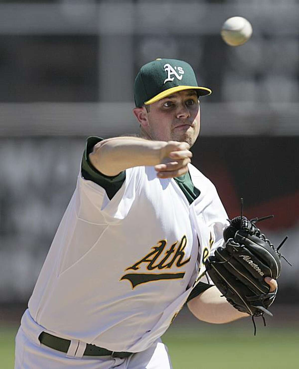 Oakland Athletics' Vin Mazzzaro works against the Los Angeles Angels during the first inning of a baseball game Sunday, Sept. 5, 2010, in Oakland, Calif.