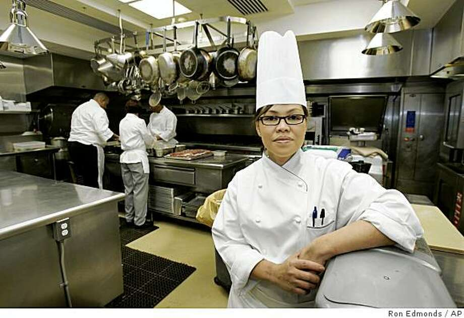 In this Dec. 12, 2006 file photo, White House Chef Cristeta Comerford pauses in the White House kitchen in Washington. Photo: Ron Edmonds, AP