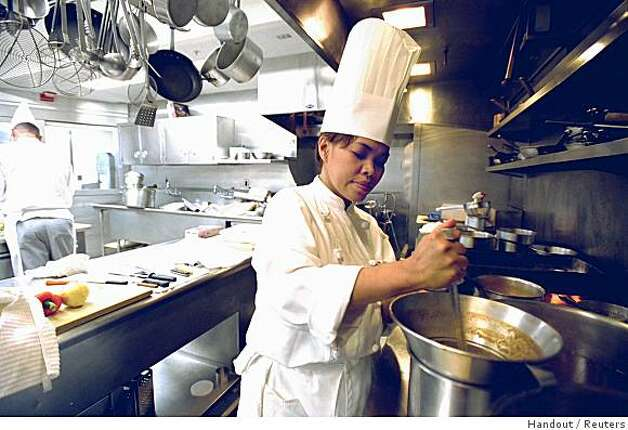 "Chef Cristeta ""Cris"" Comerford prepares a meal inside the White House kitchen in this July 17, 2002 photo. U.S. first Lady Laura Bush, on a quest for the last six months to give the White House menus a lighter, more American flair, has hired the Philippine-born Comerford as the mansion's new head chef, it was announced August 14, 2005. After trying out a number of restaurant chefs and other candidates to replace former chef Walter Scheib, the White House settled on Comerford, the first woman to hold the job. She was promoted from assistant White House chef, a job she has held since 1995. EDITORIAL USE ONLY REUTERS/Tina Hager/White House/Handout Photo: Handout, Reuters"