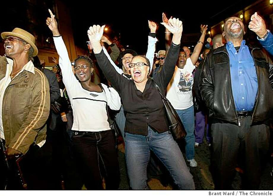 Elinor Carpenter (center in black blouse) and others danced in the streets to a local band early in the night. In Oakland January 20, 2008, Second Street between Broadway and Franklin was closed down for a block party to celebrate the inauguration of Barack Obama. The event is put on by Everett and Jones BBQ. Photo: Brant Ward, The Chronicle