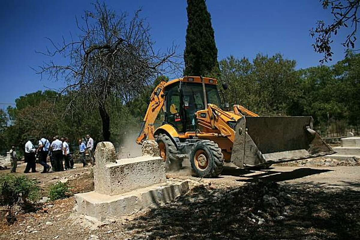 A digger moves in the grounds of the centuries-old Muslim cemetery of