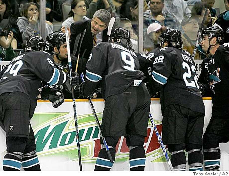 San Jose Sharks head coach Todd McLellan, center, talks to his players during a time out against the Calgary Flames in the second period of an NHL hockey game in San Jose, Calif., Thursday, Jan. 15, 2009. (AP Photo/Tony Avelar) Photo: Tony Avelar, AP