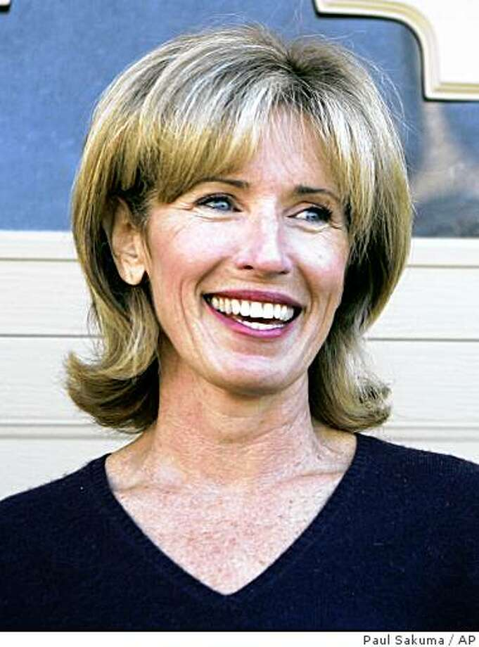 "Lorrie Sullenberger smiles outside of her Danville, Calif., home, Friday, Jan. 16, 2009, during a photo opportunity for the media. Her husband Chesley ""Sully"" Sullenberger is the pilot who landed his US Airways jet on the Hudson River in New York on Thursday, with all passengers and crew escaping safely. (AP Photo/Paul Sakuma) Photo: Paul Sakuma, AP"