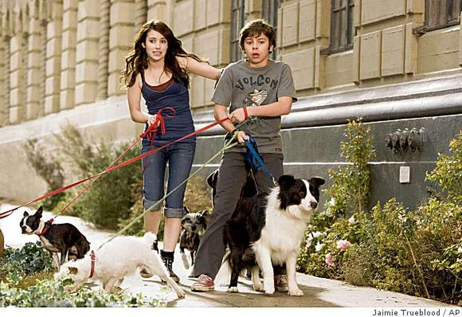 "In this image released by Dreamworks Pictures, Emma Roberts, left and Jake T. Austin are shown in a scene from ""Hotel for Dogs."" Photo: Jaimie Trueblood, AP"