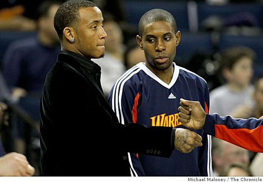 Golden State Warriors Monta Ellis (left)  greets his fellow players including C.J. Watson (center) prior to a NBA game against the Toronto Raptors at Oracle Arena in Oakland, Calif., on Monday, December 29, 2008. Photo: Michael Maloney, The Chronicle