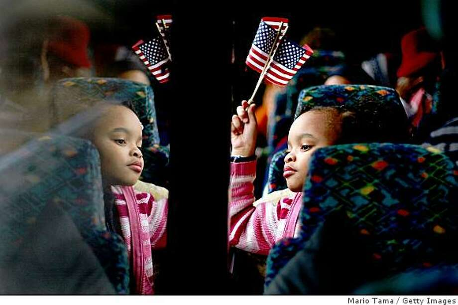 "IN TRANSIT, UNITED STATES - JANUARY 19:  Torri Tippett, 8, from Birmingham, Alabama rides on a bus with Alabamans on the way to Washington, DC to attend the inauguration of President-elect Barack Obama January 19, 2009 In Transit to Washington, DC. Birmingham, along with Selma and Montgomery, were touchstones in the civil rights movement where Dr. Martin Luther King Jr. led massive protests which eventually led to the Voting Rights Act of 1965 ending voter disfranchisement against African-Americans. Obama will become America's first black president 45 years after Dr. King's ""I Have a Dream"" civil rights speech in Washington, DC.  (Photo by Mario Tama/Getty Images) Photo: Mario Tama, Getty Images"