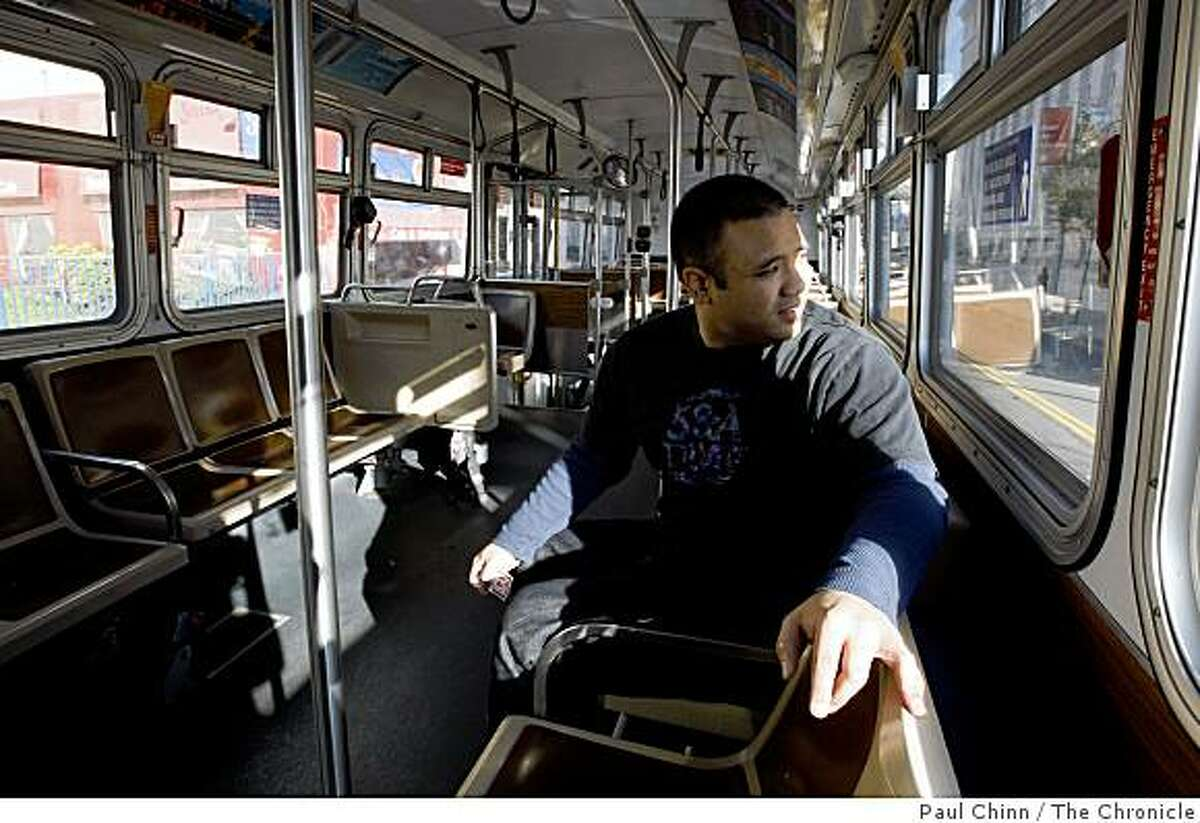 Visiting from San Diego, Brian Ballestamon had the Culture Bus all to himself as he rode from Union Square to the Academy of Sciences in San Francisco, Calif., on Wednesday, Jan. 14, 2009. Muni launched the Culture Bus in the Fall of 2008 as a convenient way for visitors to hop on and off at several museums for a $7 all-day fare.