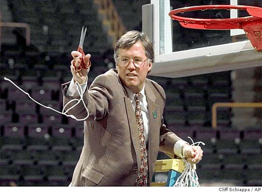 : Stanford head coach Mike Montgomery throws a piece of the net to players after his team beat Rhode Island 79-77 in the NCAA Midwest Regional final, Sunday, March 22, 1998, at the Kiel Center in St. Louis. The win clinched a trip to the Final Four in San Antonio. (AP Photo/Cliff Schiappa) Stanford head coach Mike Montgomery throws a piece of the net to players after his team beat Rhode Island 79-77 in the NCAA Midwest Regional final, Sunday, March 22, 1998, at the Kiel Center in St. Louis. The win clinched a trip to the Final Four in San Antonio. (AP Photo/Cliff Schiappa) Photo: Cliff Schiappa, AP