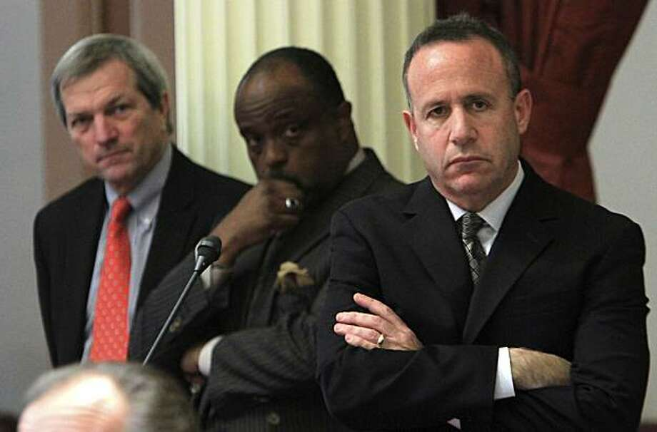 State Senate President Pro Tem Darrell Steinberg, D-Sacramento, right, along with Sen. Rod Wright, D-Inglewood, center, and Sen. Mark DeSaulnier, D-Concord, listen as Sen. Bob Huff, R-Diamond Bar, unseen, speaks against a Democratic budget plan before theSenate at the Capitol  in Sacramento, Calif., Tuesday, Aug. 31, 2010. Lawmakers rejected two different versions of the state budget, one, proposed by the Democrats and the other, a Republican plan, leaving the state two months into the 2010-2011 fiscal year without a spending plan. Photo: Rich Pedroncelli, AP